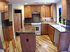 custom kitchen with granite and wood floors.